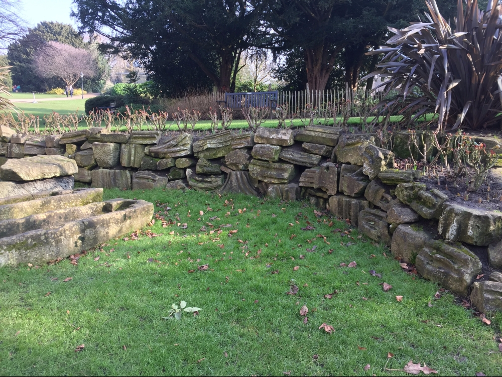 retaining wall built out of abbey ruin stone pieces