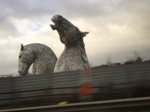 The Kelpies giant horse statues, as seen from the car