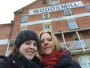 Posing in front of Woodsmill Quay, a wood mill converted into apartments
